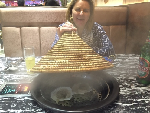 """Scallops being cooked in the """"hot pot"""""""