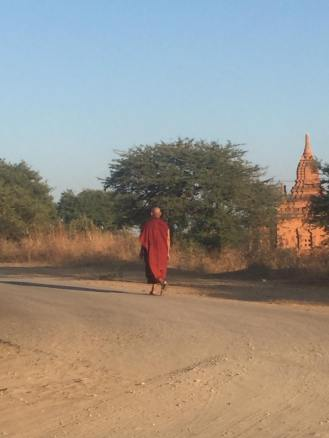 Monk walking the highway