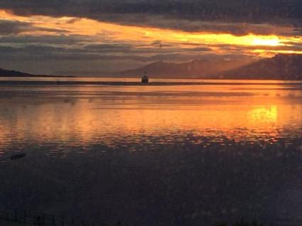 Ship goes off into the morning sunrise