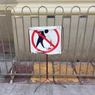 No spitting on the pavements - they like to chew red betel nut which leaves stains everywhere, including on their teeth