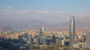 Smog makes the Andes look hazy in the background of the city