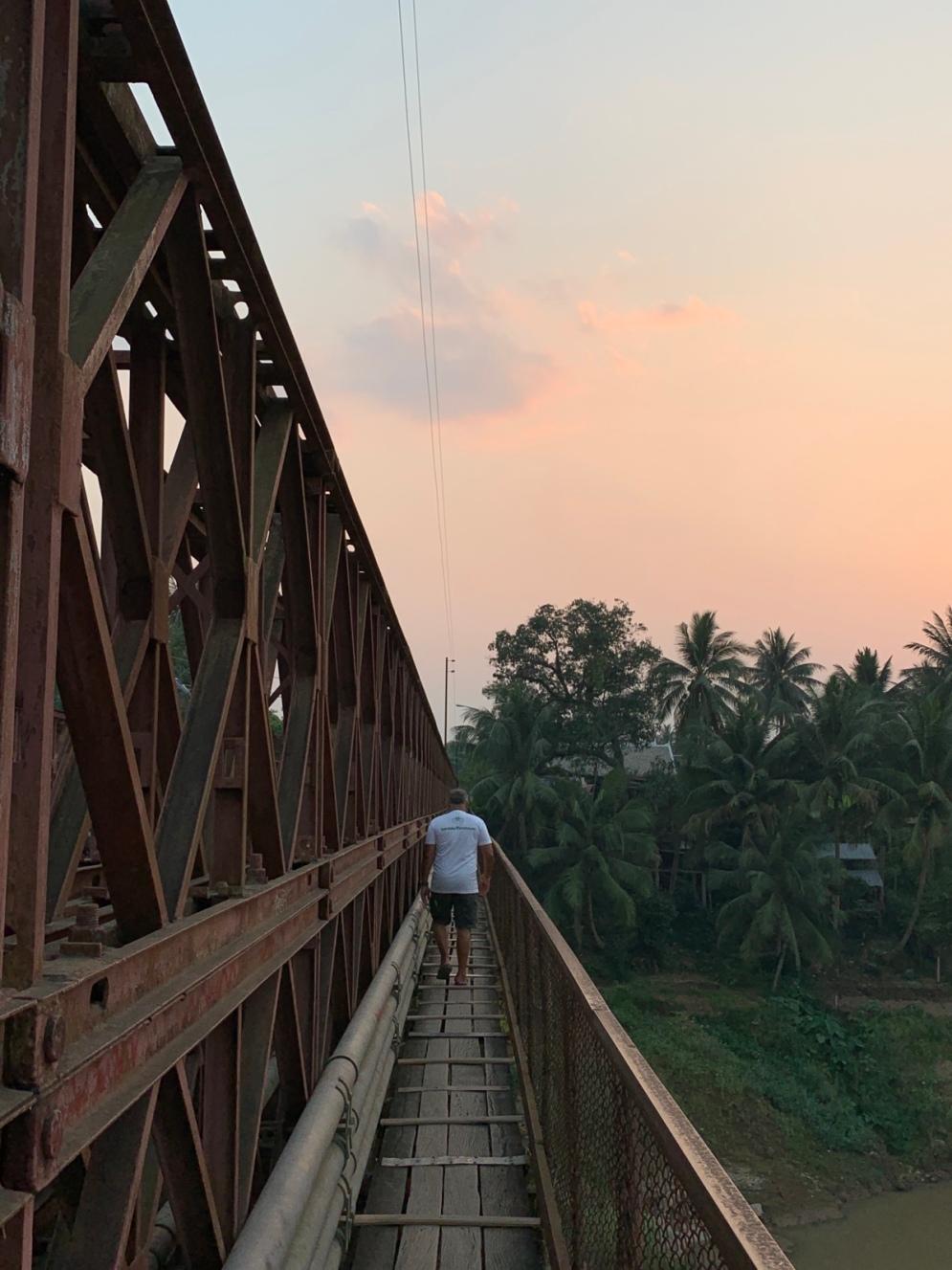 Walking along the Old Bridge by dusk